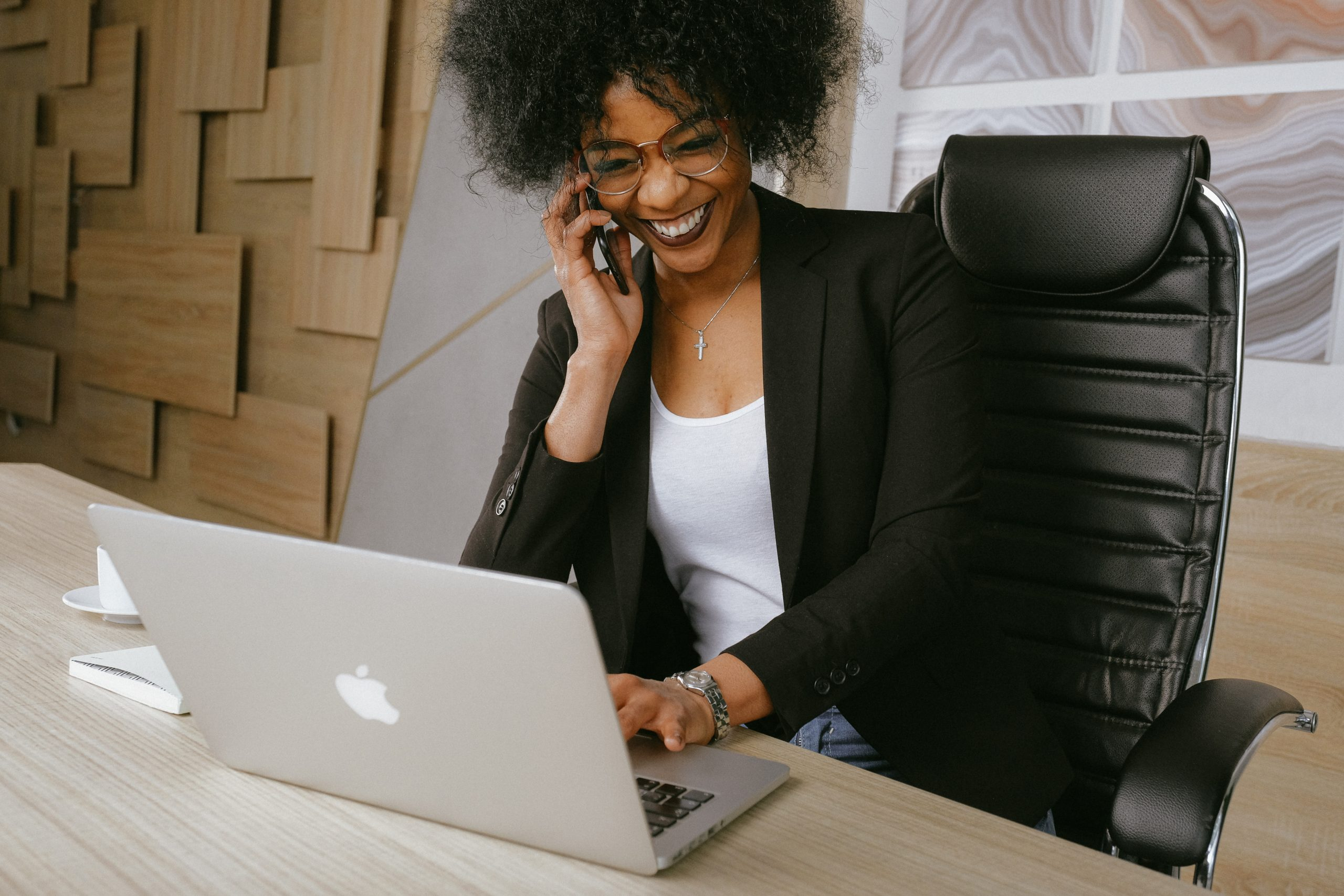 woman-in-black-blazer-sitting-on-black-office-chair-3727464